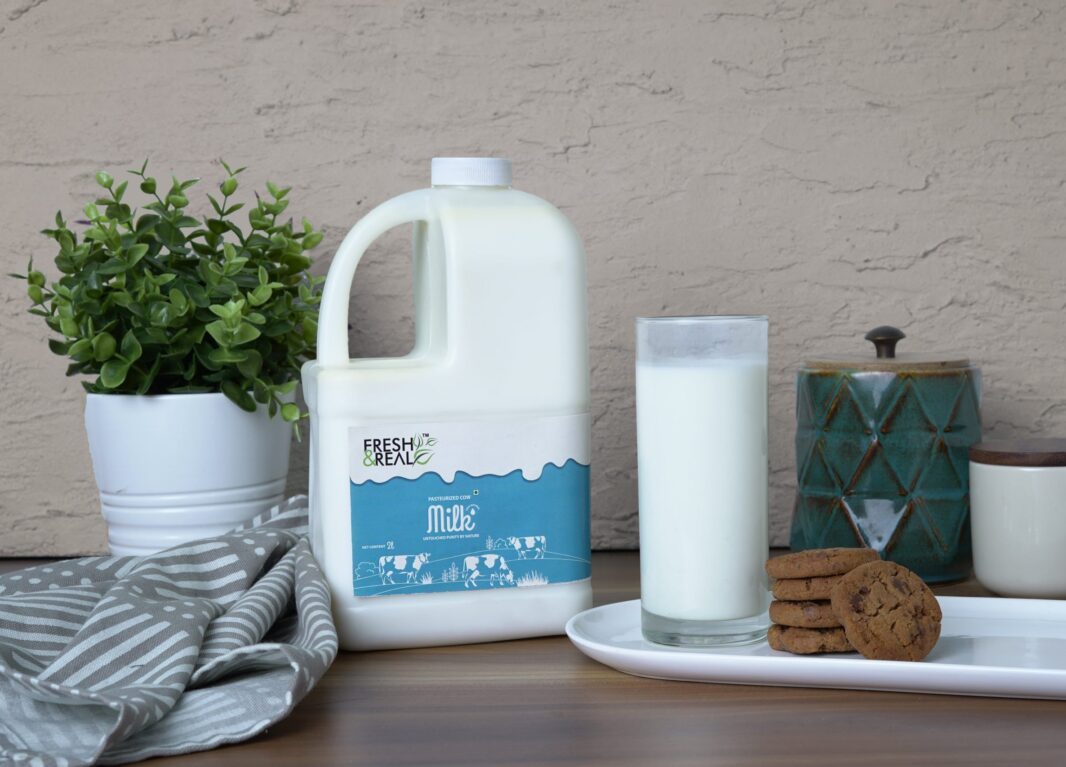 Plastic milk cane with a glass of milk and cookies